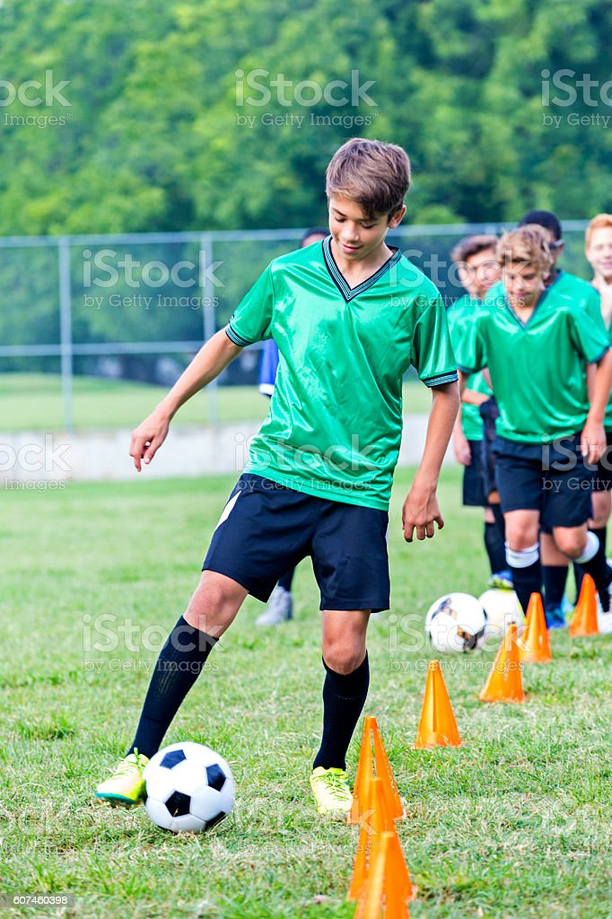 Teenage soccer player at practice stock photo