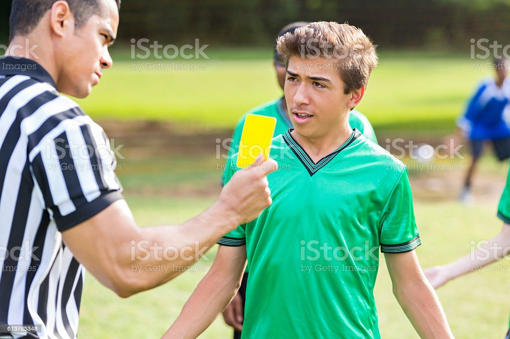 Teenage soccer player is upset over referee's call stock photo