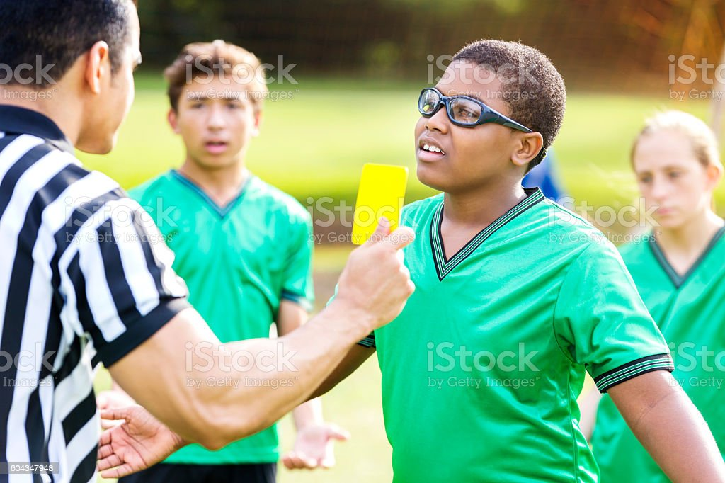 Teenage soccer player upset with referee's call stock photo