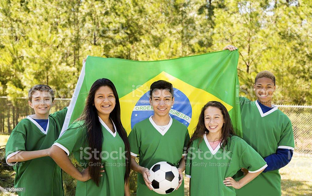 Teenage soccer team with Brazilian flag. royalty-free stock photo