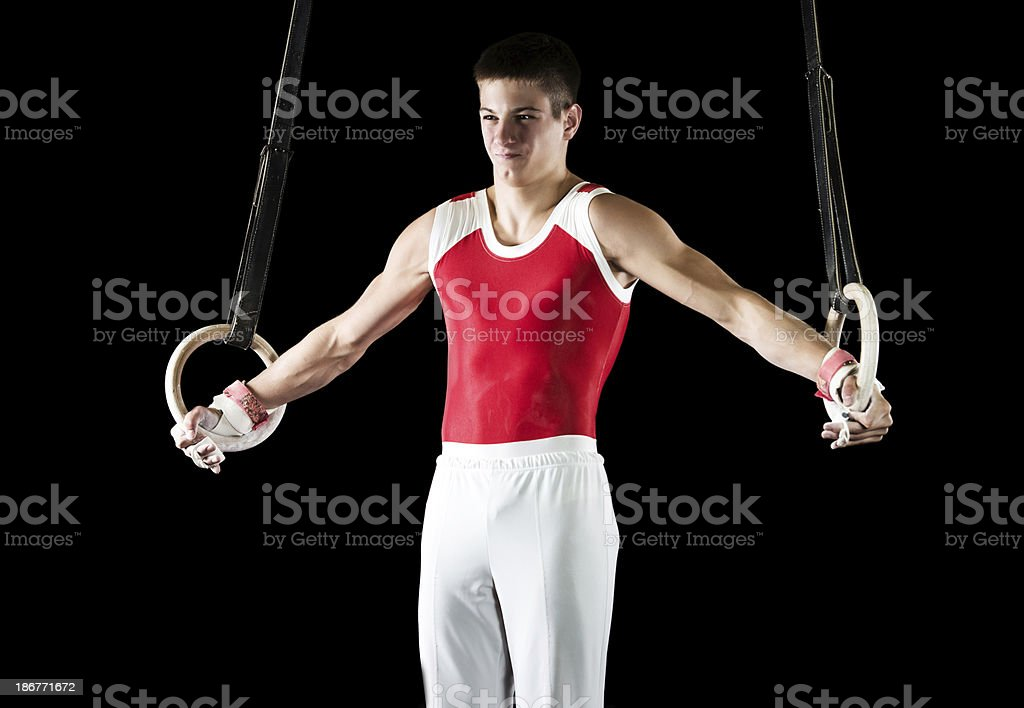 Teenage sportsman on gymnastics rings. royalty-free stock photo