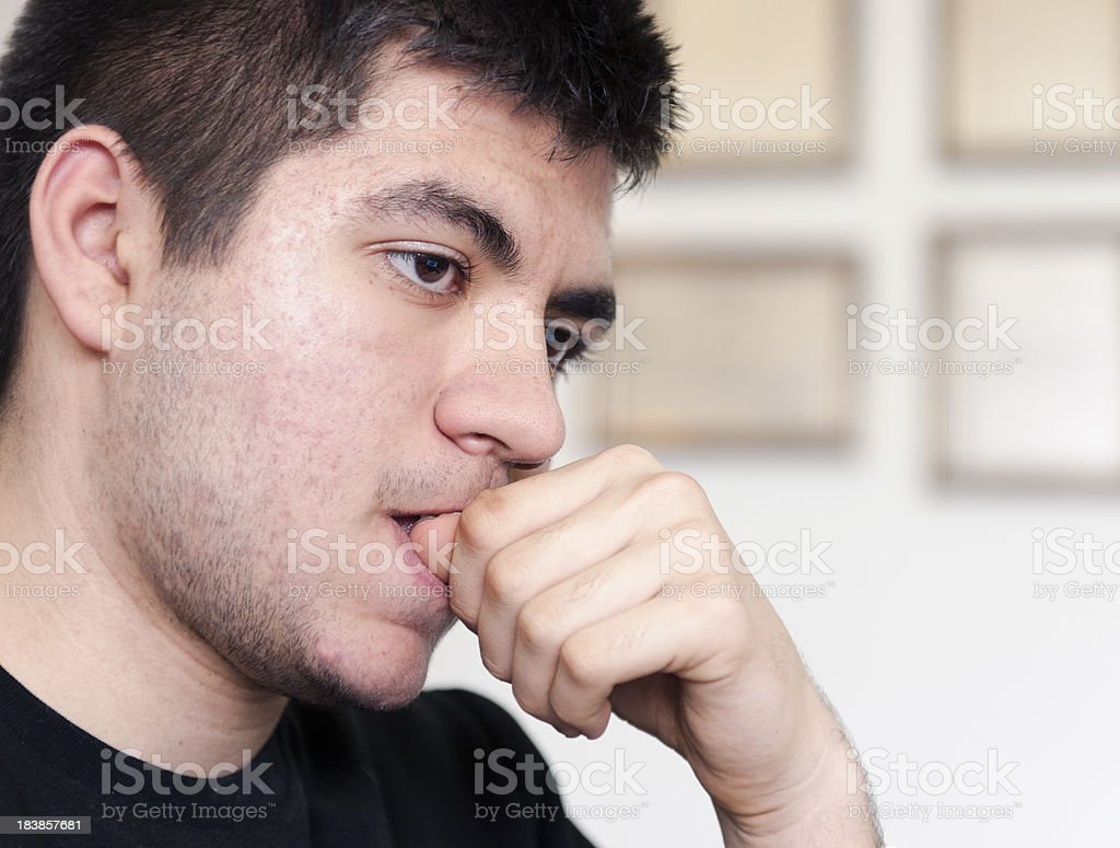 Teenage Student biting nails. stock photo