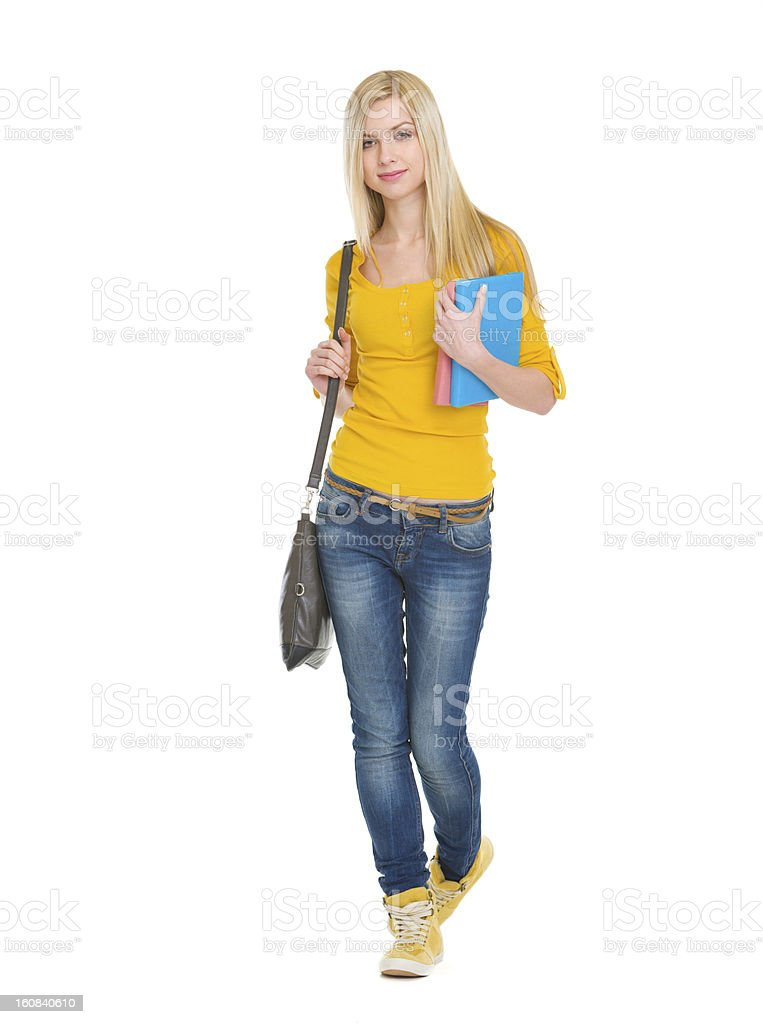Teenage student girl with books going forward royalty-free stock photo