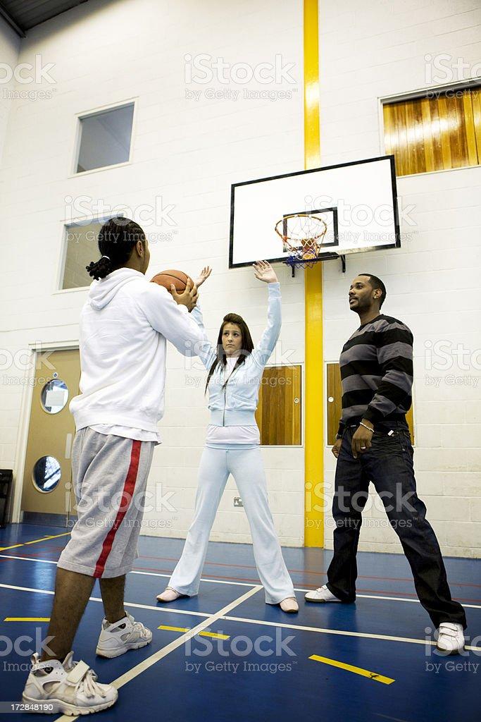 teenage students: basketball class stock photo