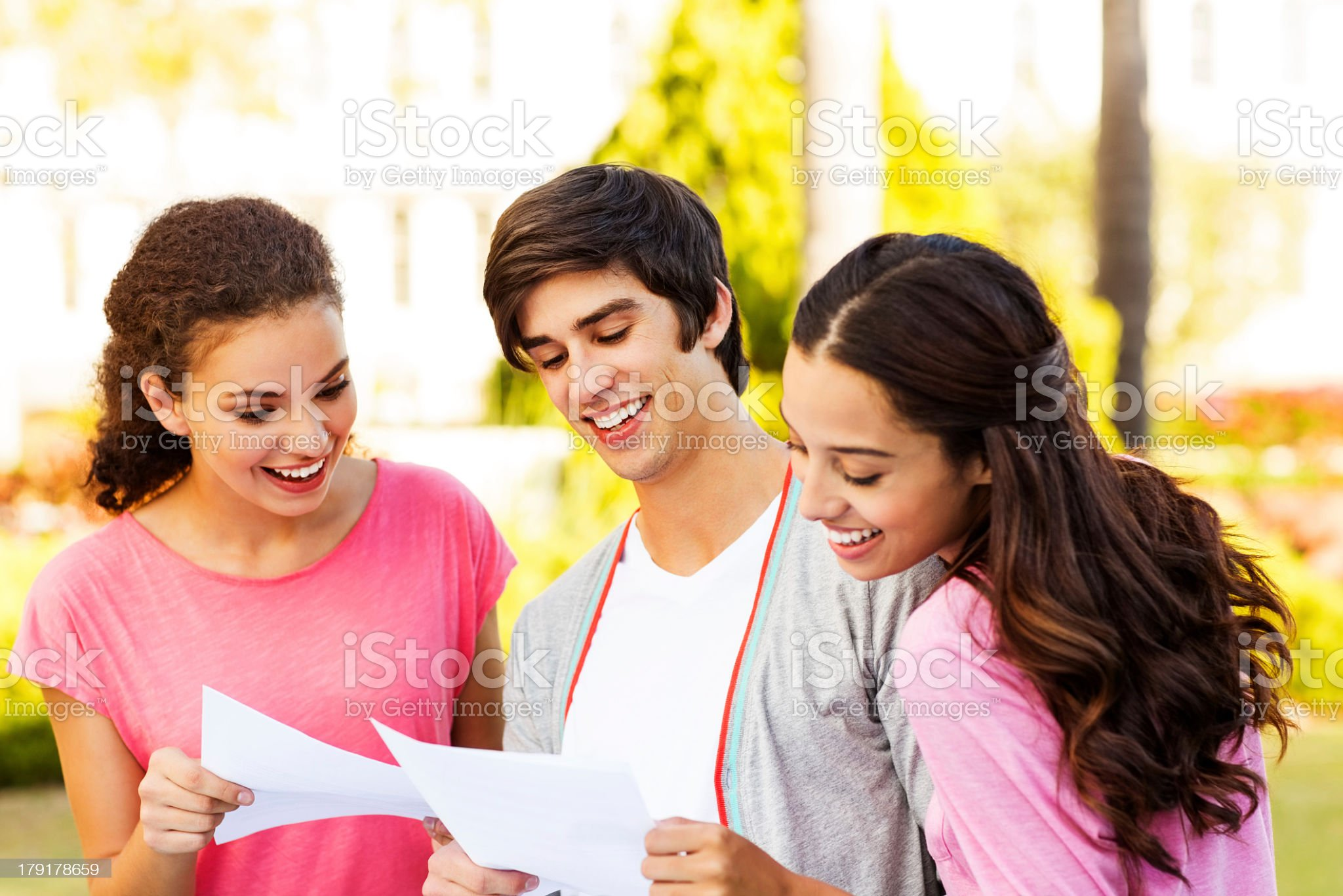 Teenage Students Checking Test Results On College Campus royalty-free stock photo