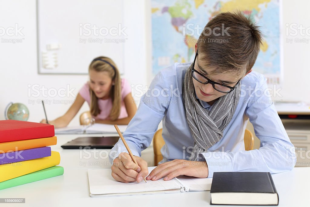Teenage students in class royalty-free stock photo