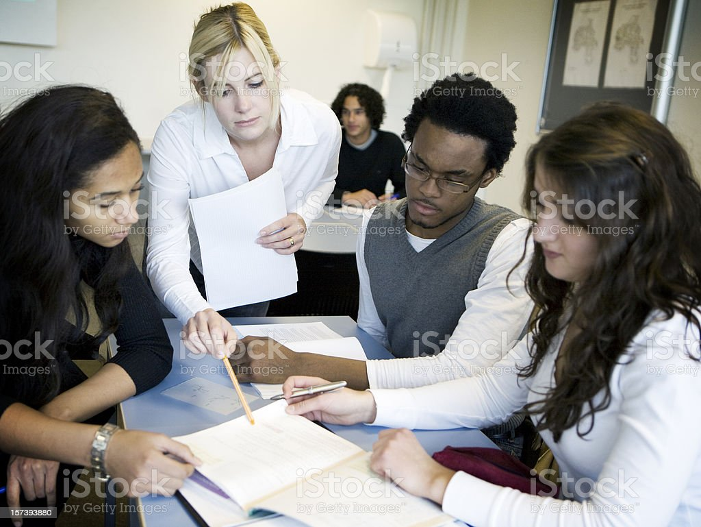 Teenage students in class study session stock photo