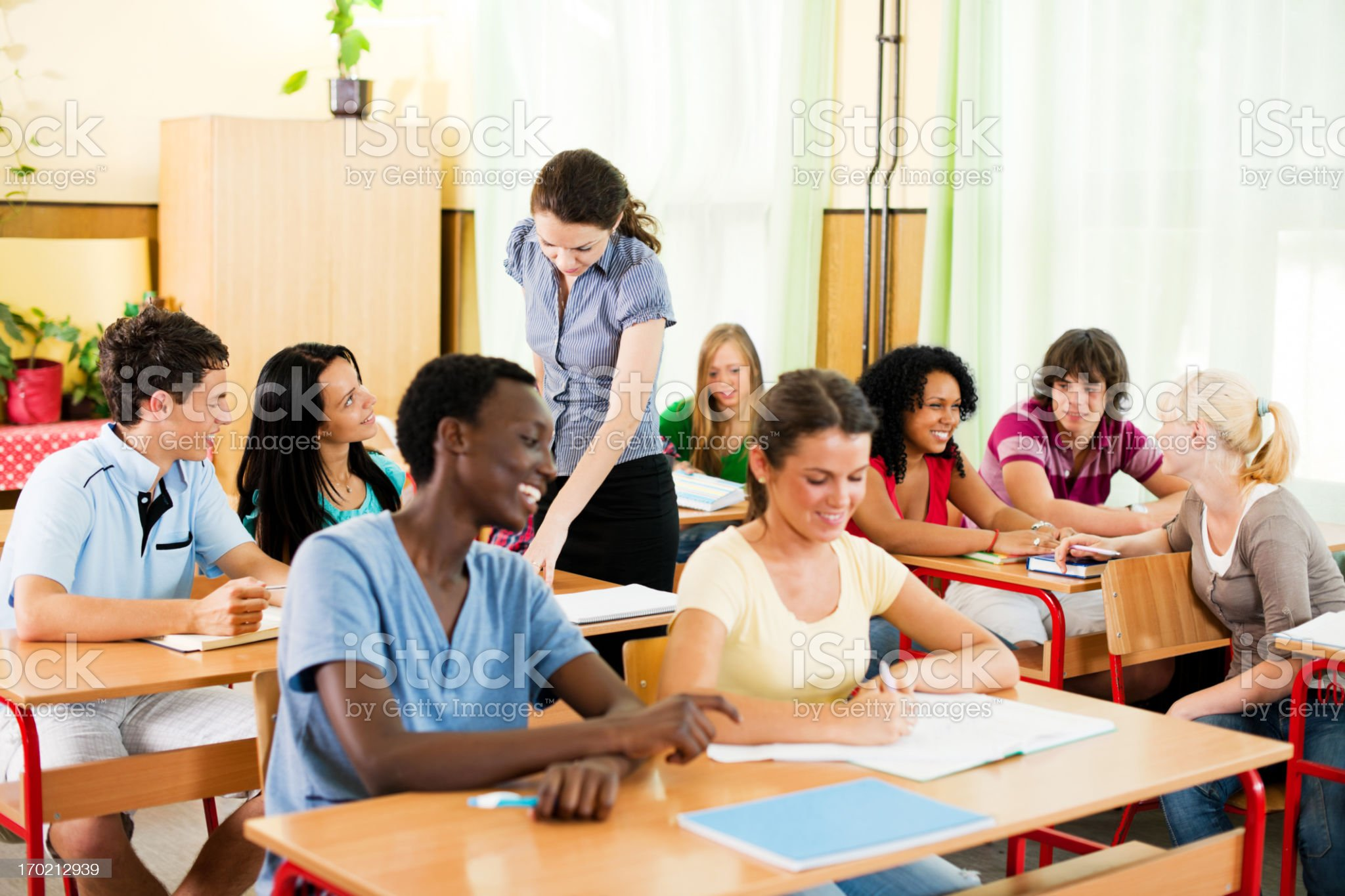 Teenage students in the classroom with teacher. royalty-free stock photo