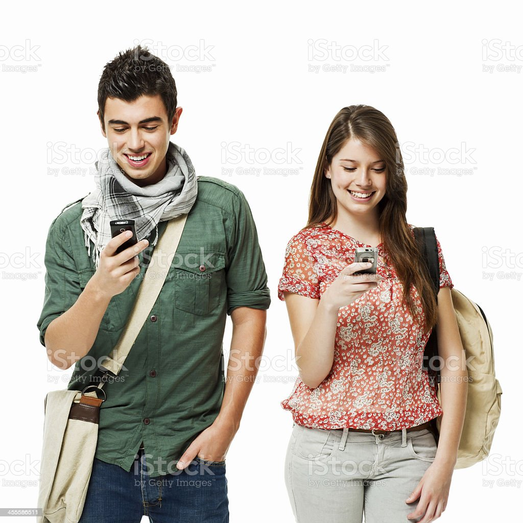 Teenage Students on Cellphones - Isolated royalty-free stock photo
