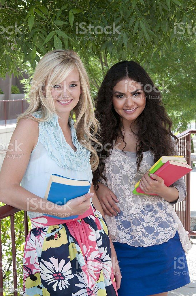 Teenage students with books, mixed ethnicity - I royalty-free stock photo