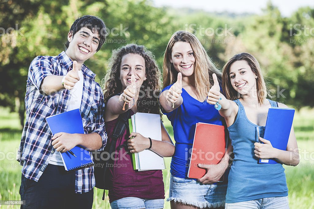 Teenage Students with Thumbs up stock photo