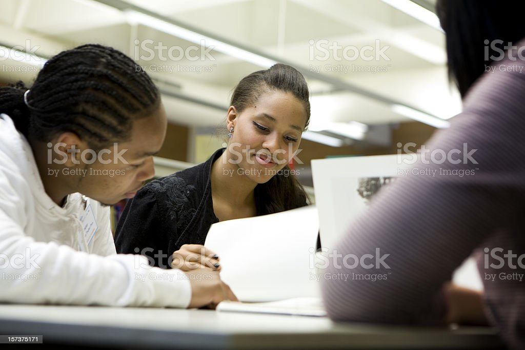 teenage students working together on a school project in class royalty-free stock photo