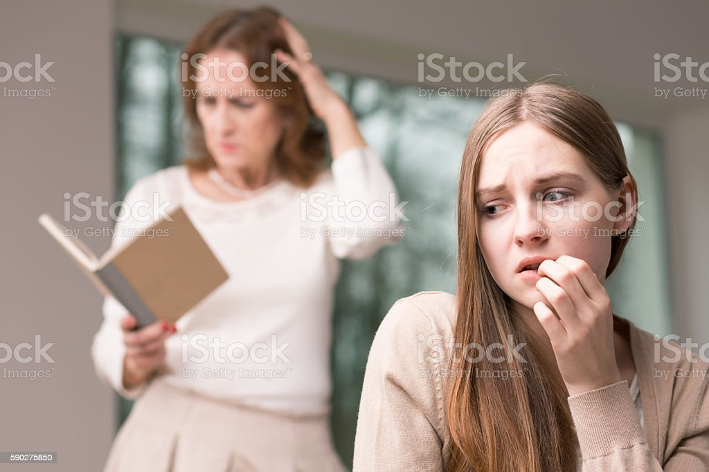 Teenage worried girl and her revealed secrets stock photo