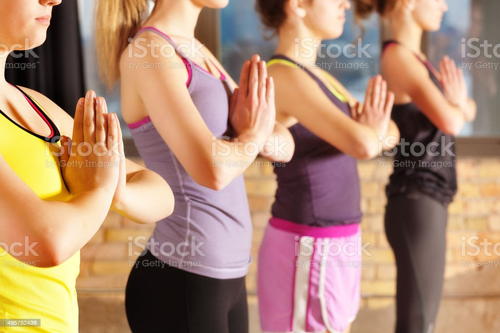 Teenage Yoga Class Group, Women Exercising in Health Club Gym stock photo