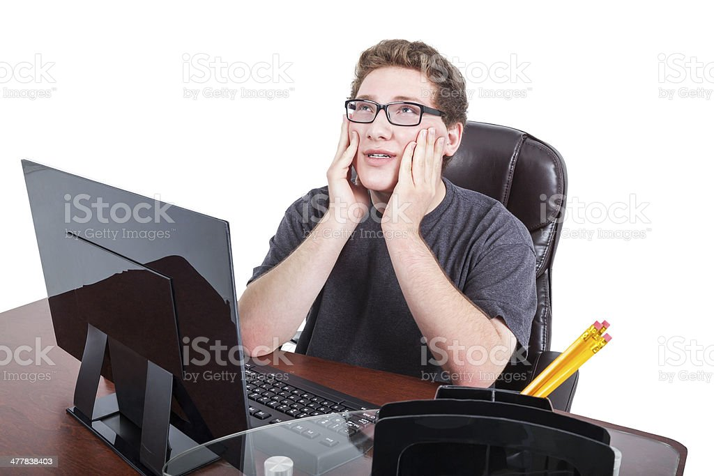 Teenaged boy puzzled by his homework on computer royalty-free stock photo
