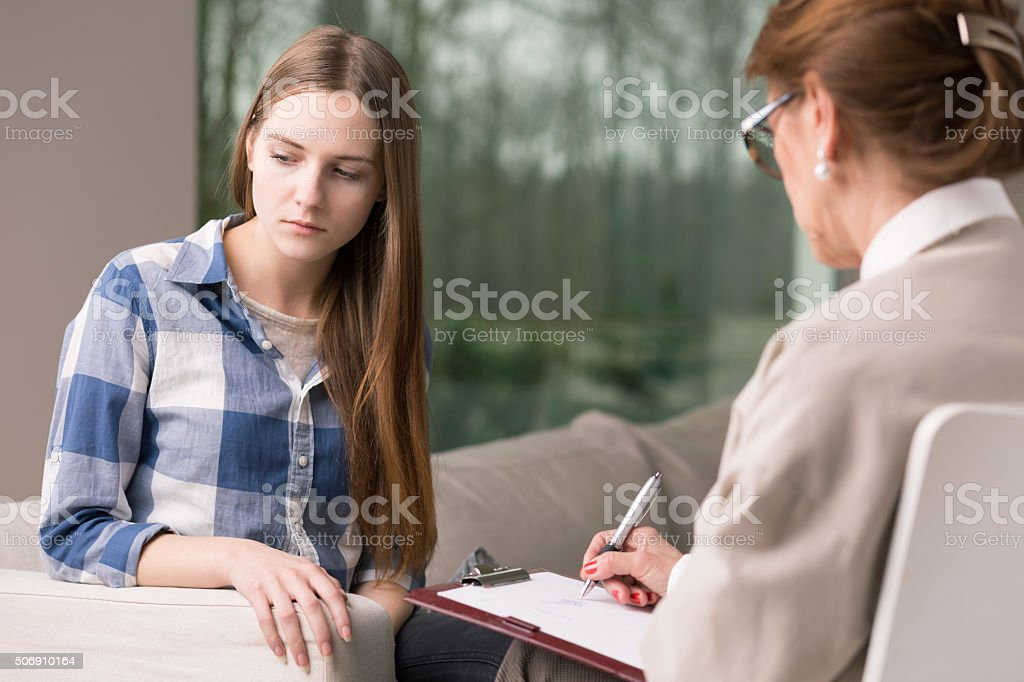 Teenager and psychotherapist stock photo