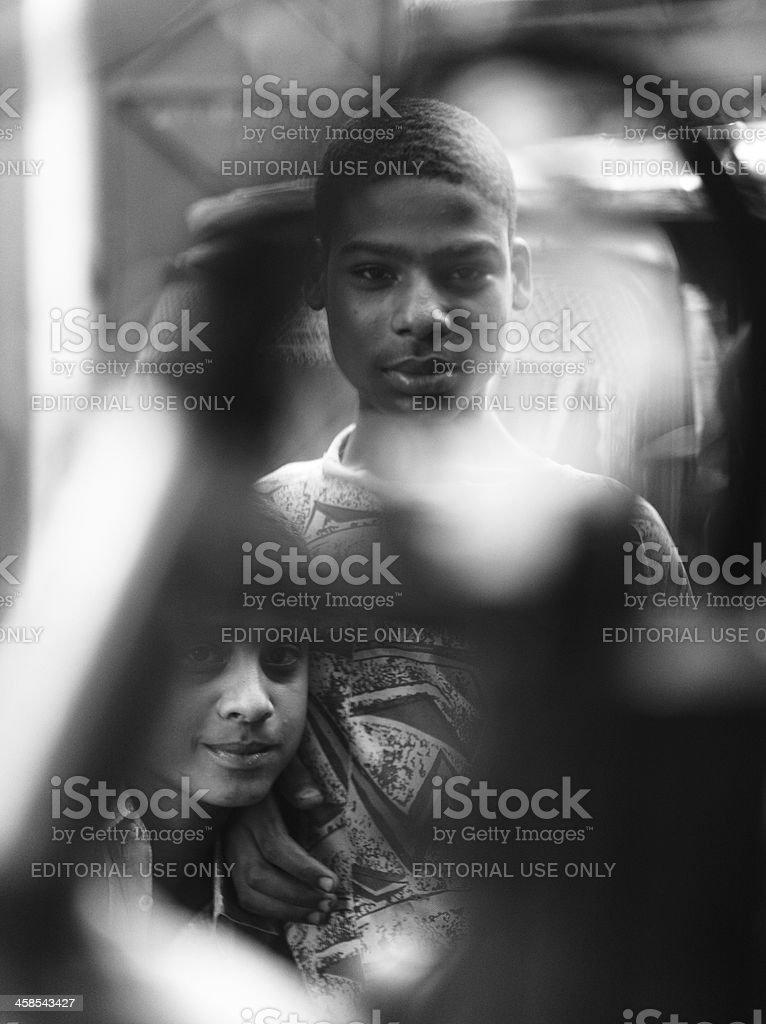 Teenager at Car Repair Garage Karachi Shershah Scrap Market royalty-free stock photo