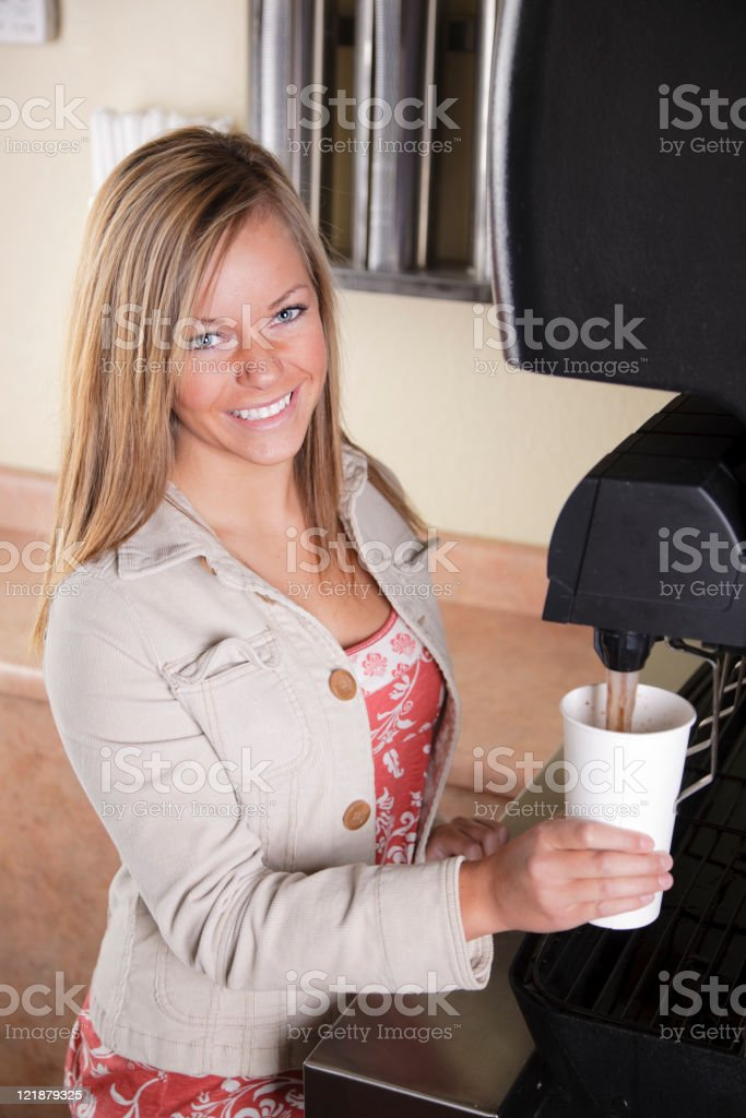 Teenager at Soda Fountain in Fast Food Restaurant royalty-free stock photo