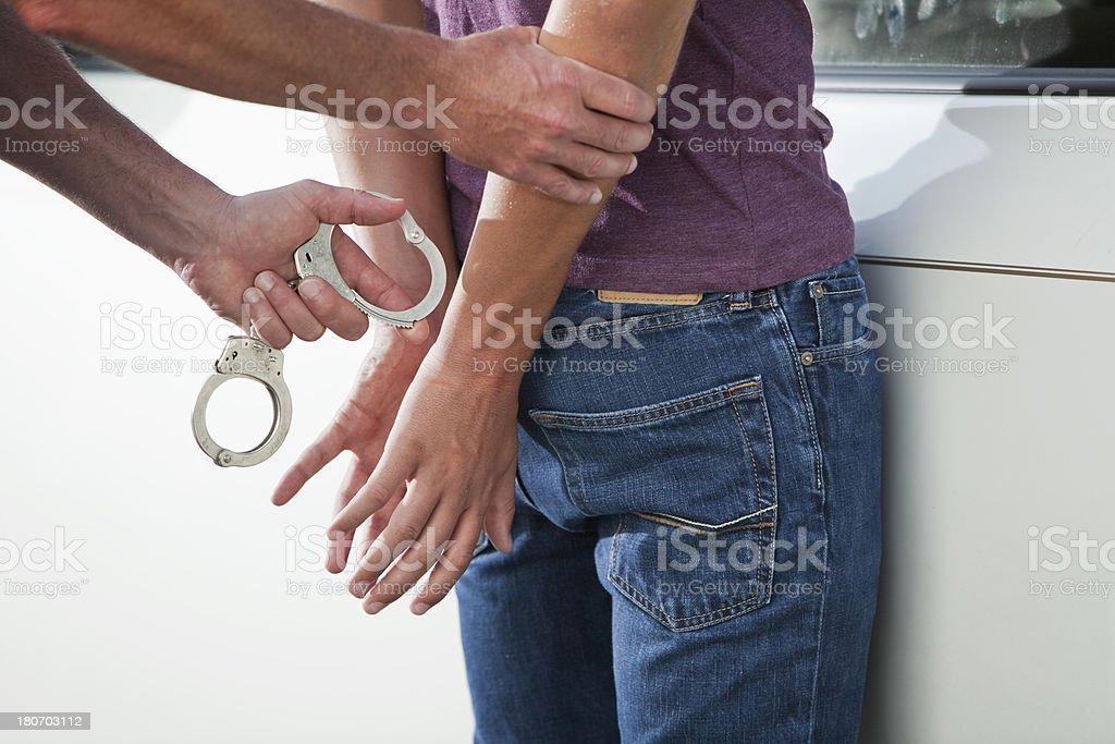 Teenager being handcuffed stock photo