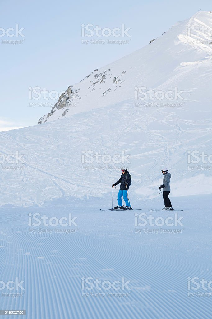 Teenager boy and girl snow skiers enjoying   Perfectly ski slopes stock photo