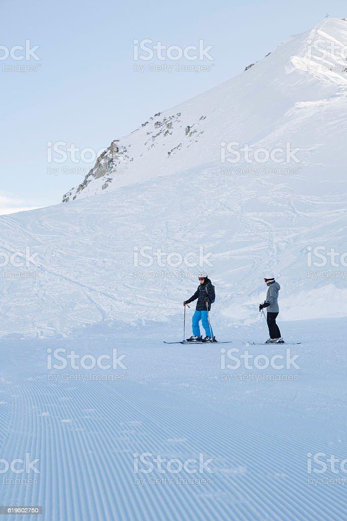 Teenager boy and girl snow skiers enjoying   Perfectly ski slopes stock photo