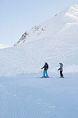 Teenager boy and girl snow skiers enjoying   Perfectly ski slopes