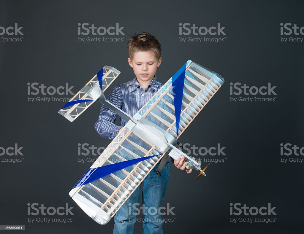 Teenager boy has holding the model airplane. Hobby. stock photo
