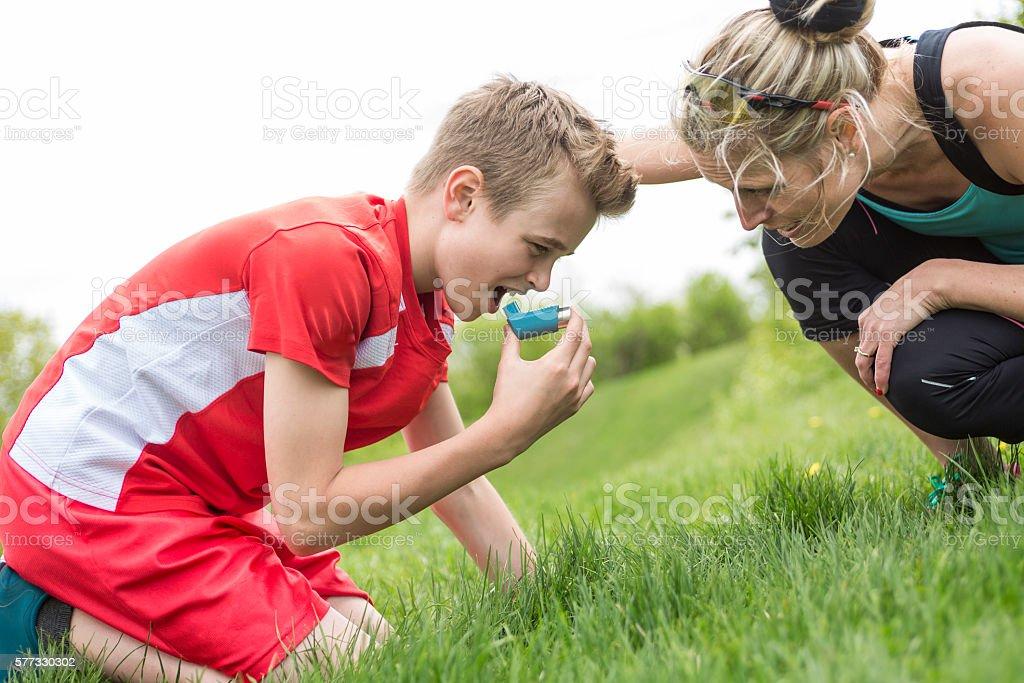 teenager boy in sportswear run outside stock photo