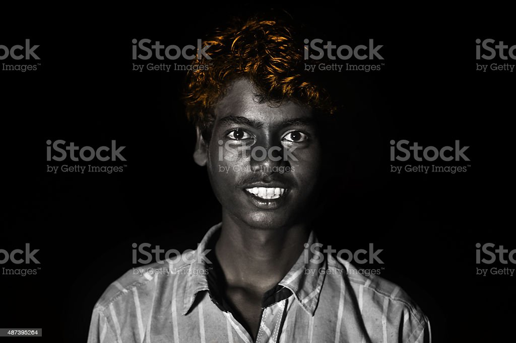 Teenager Boy Laughing portrait Isolated on Black stock photo