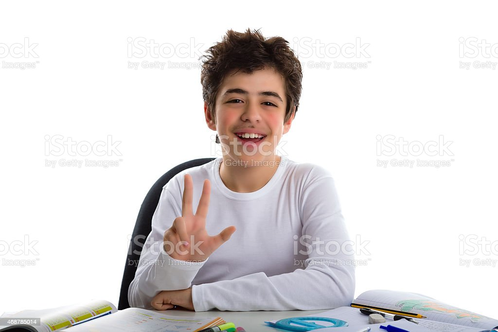 teenager boy on homeworks smiling and showing number 3 stock photo