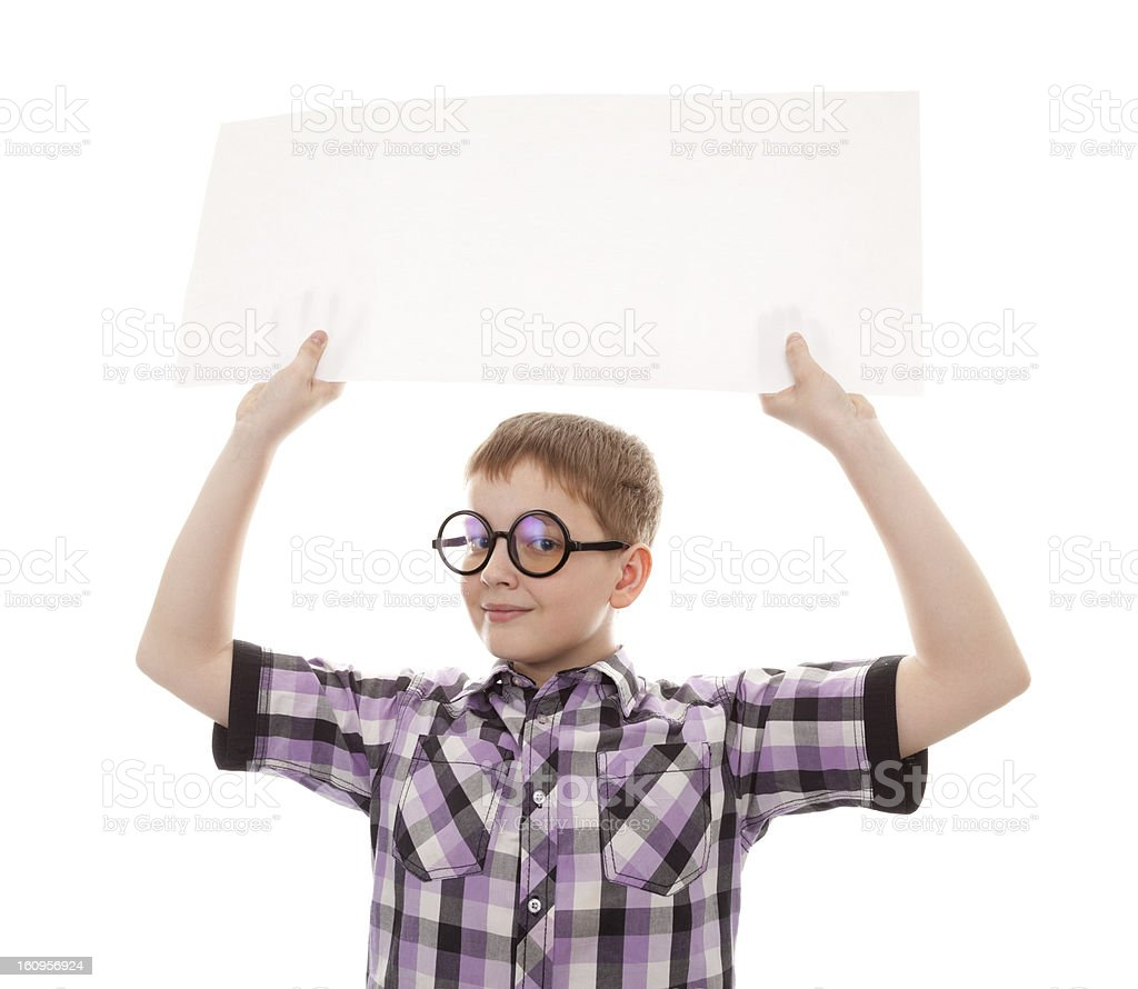 teenager boy standing by white blank card royalty-free stock photo