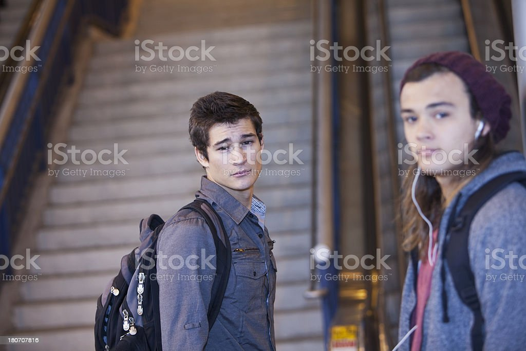 Teenager boys at bottom of stairs stock photo