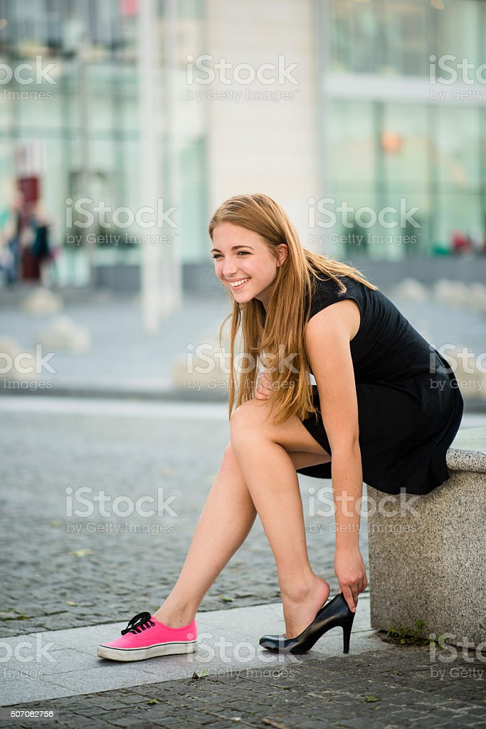 Teenager changing shoes stock photo