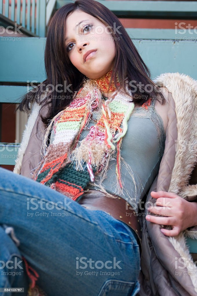 Teenager Daydreaming on Metal Steps stock photo