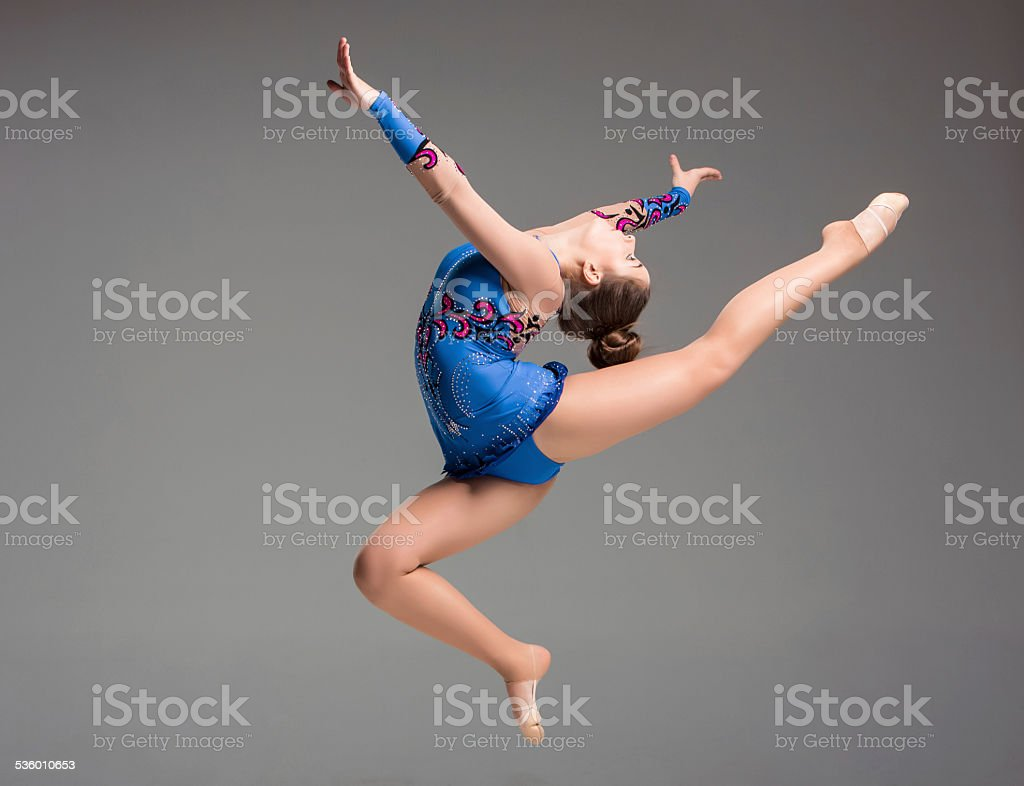 teenager doing gymnastics dance stock photo