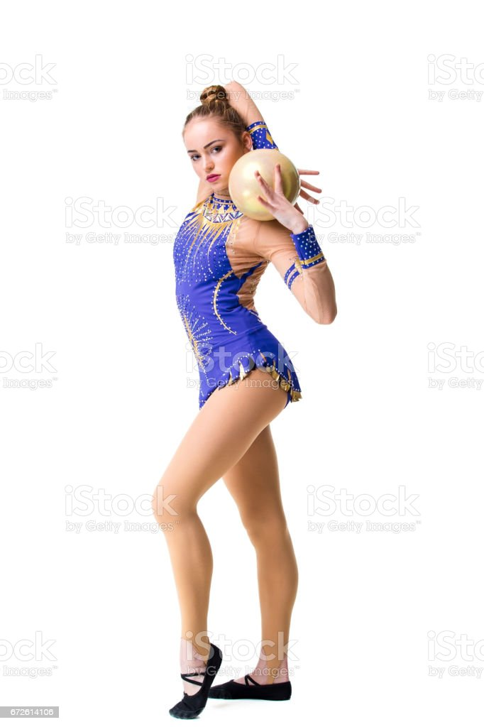 teenager doing gymnastics exercises with gymnastic ball. isolated stock photo