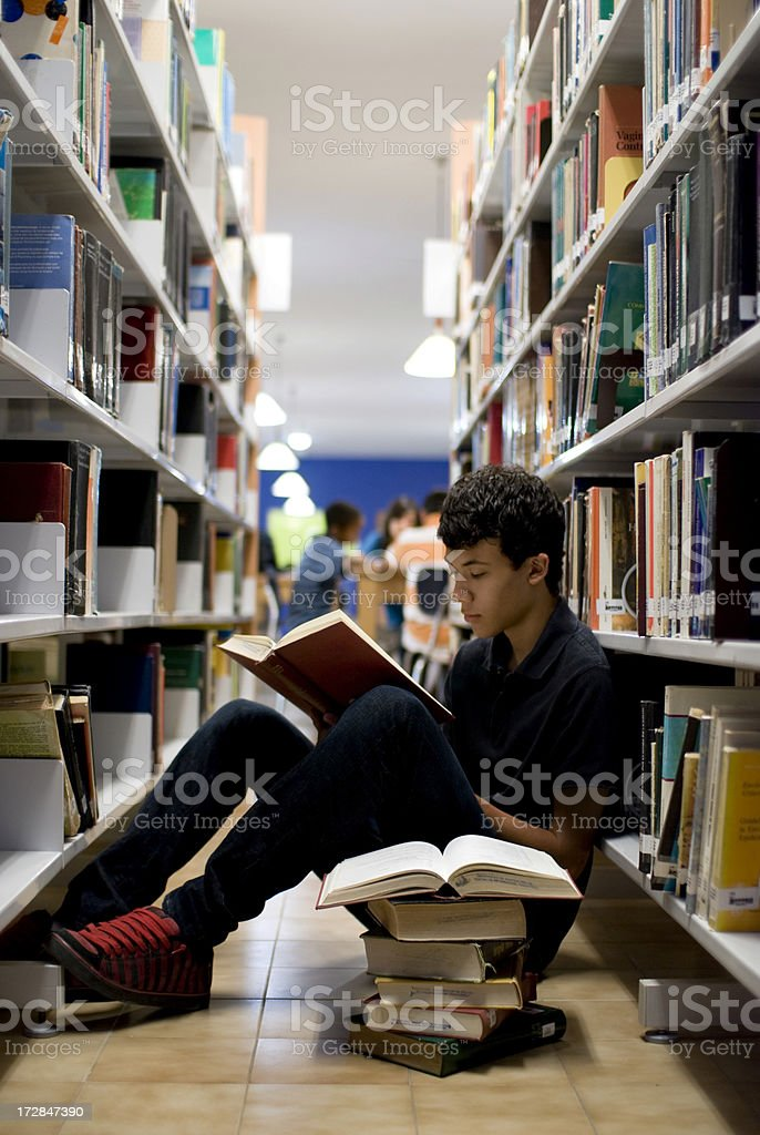 Teenager doing homework royalty-free stock photo