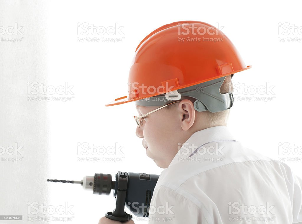 Teenager drill the wall royalty-free stock photo