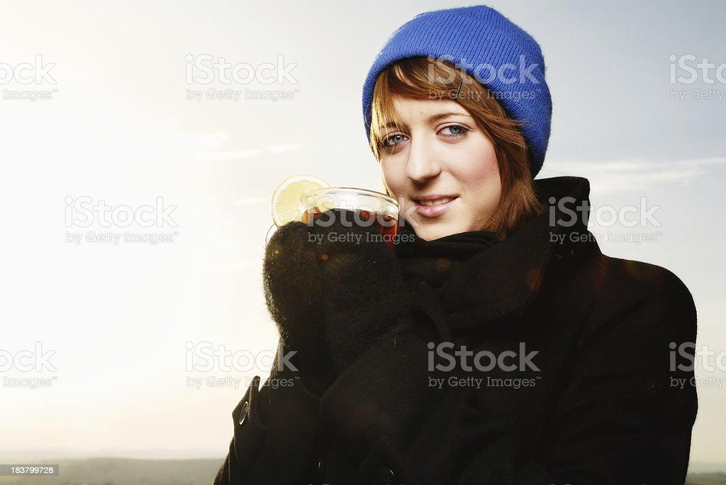 teenager drinking hot tea in winter royalty-free stock photo