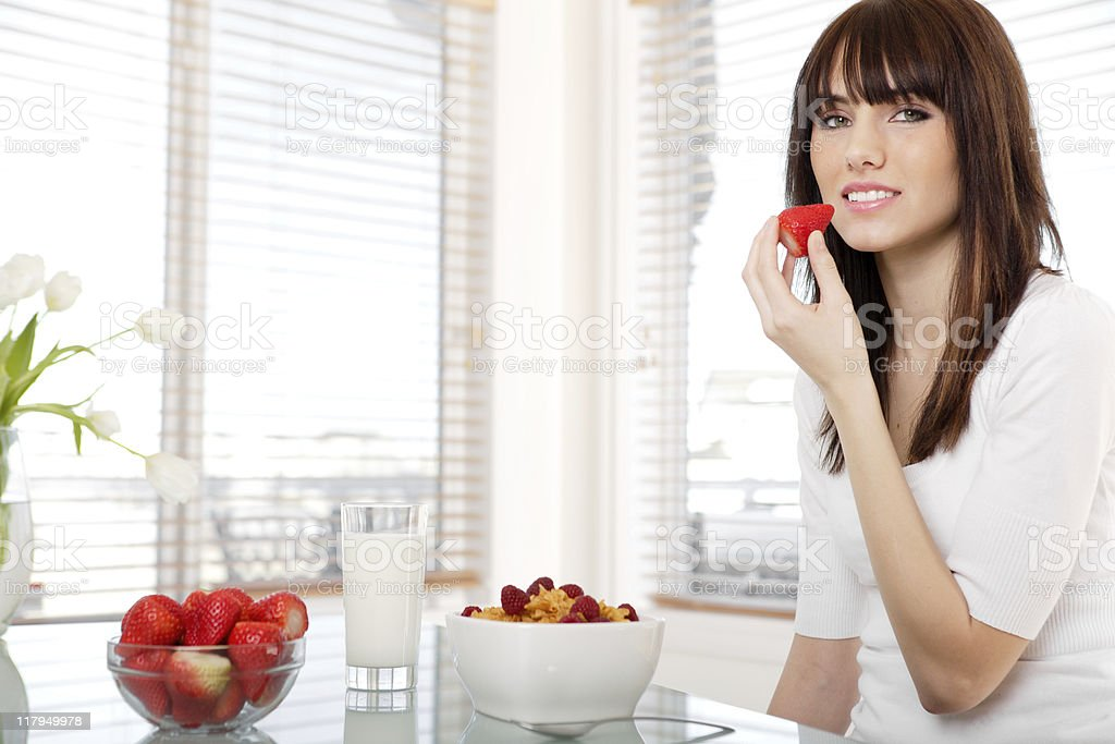 Teenager eating breakfast royalty-free stock photo
