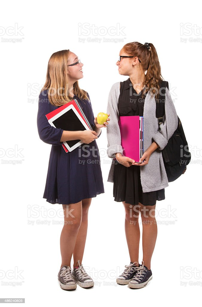 Teenager femal students talking, full length isolated royalty-free stock photo
