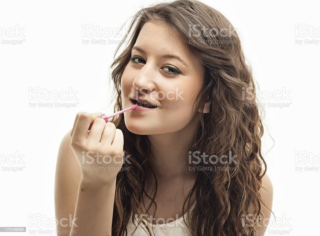 Teenager girl applying lipstick royalty-free stock photo