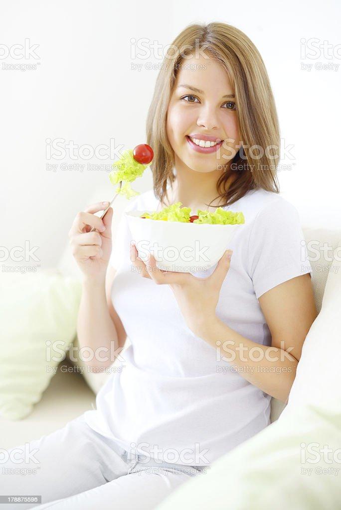 Teenager girl eating salad royalty-free stock photo