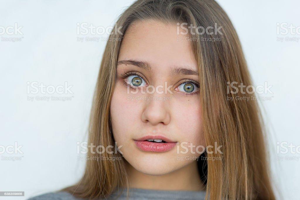 Teenager girl emotional posing isolated stock photo