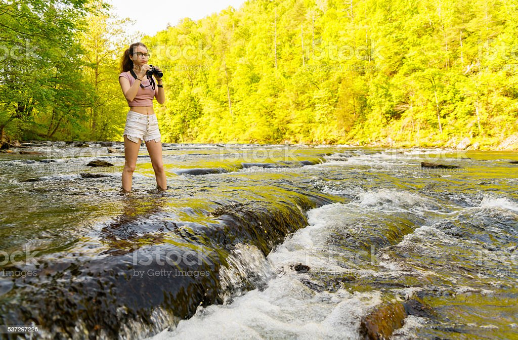 Teenager girl exploring wildlife. Oosterneck Creek, Great Smoky Mountains, Tennessee stock photo