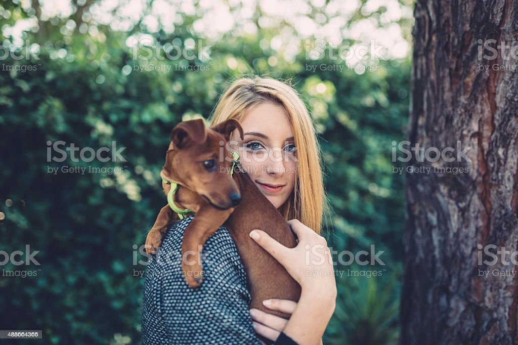 Teenager girl holding a cute puppy stock photo