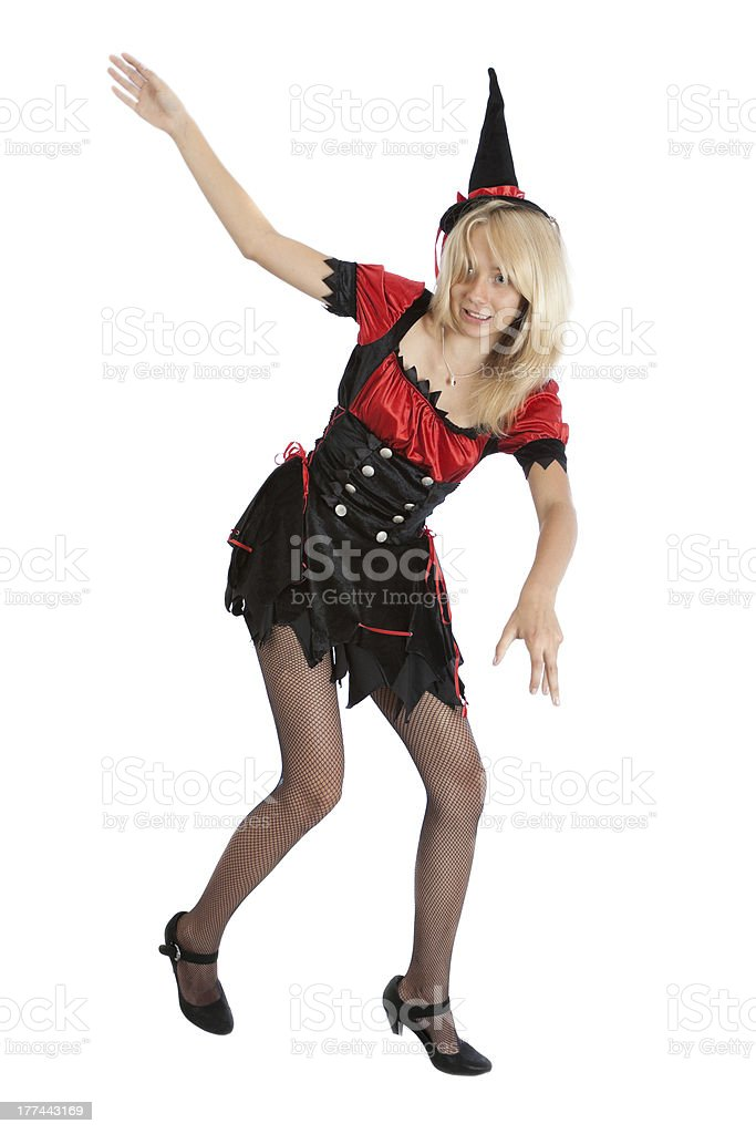 teenager girl in Halloween witch costume falls royalty-free stock photo