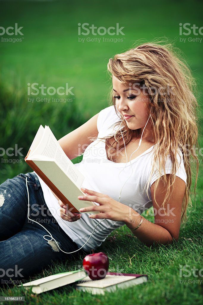 Teenager Girl Reading a Book royalty-free stock photo