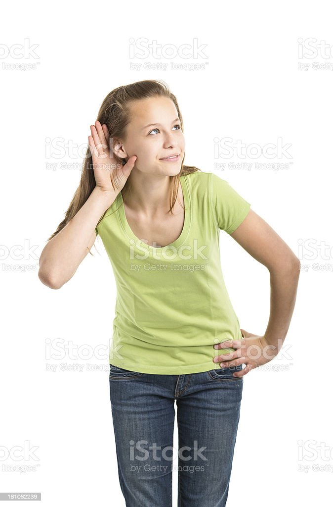 teenager girl standing and listening royalty-free stock photo