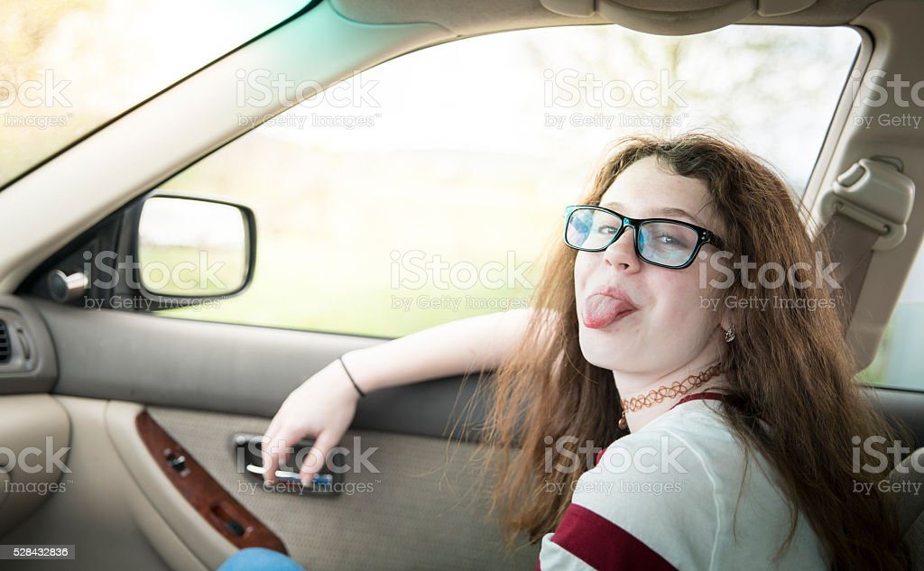 Teenager girl travel in the car stock photo